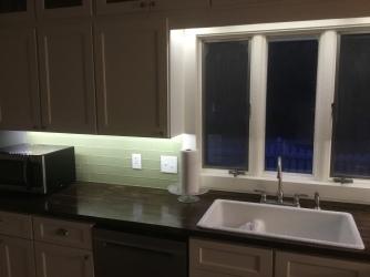 Under-cabinet lighting at night