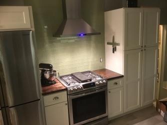 Gas range, range hood, pantry cabinet, refrigerator