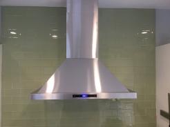 Range hood and glass subway tile backslpash
